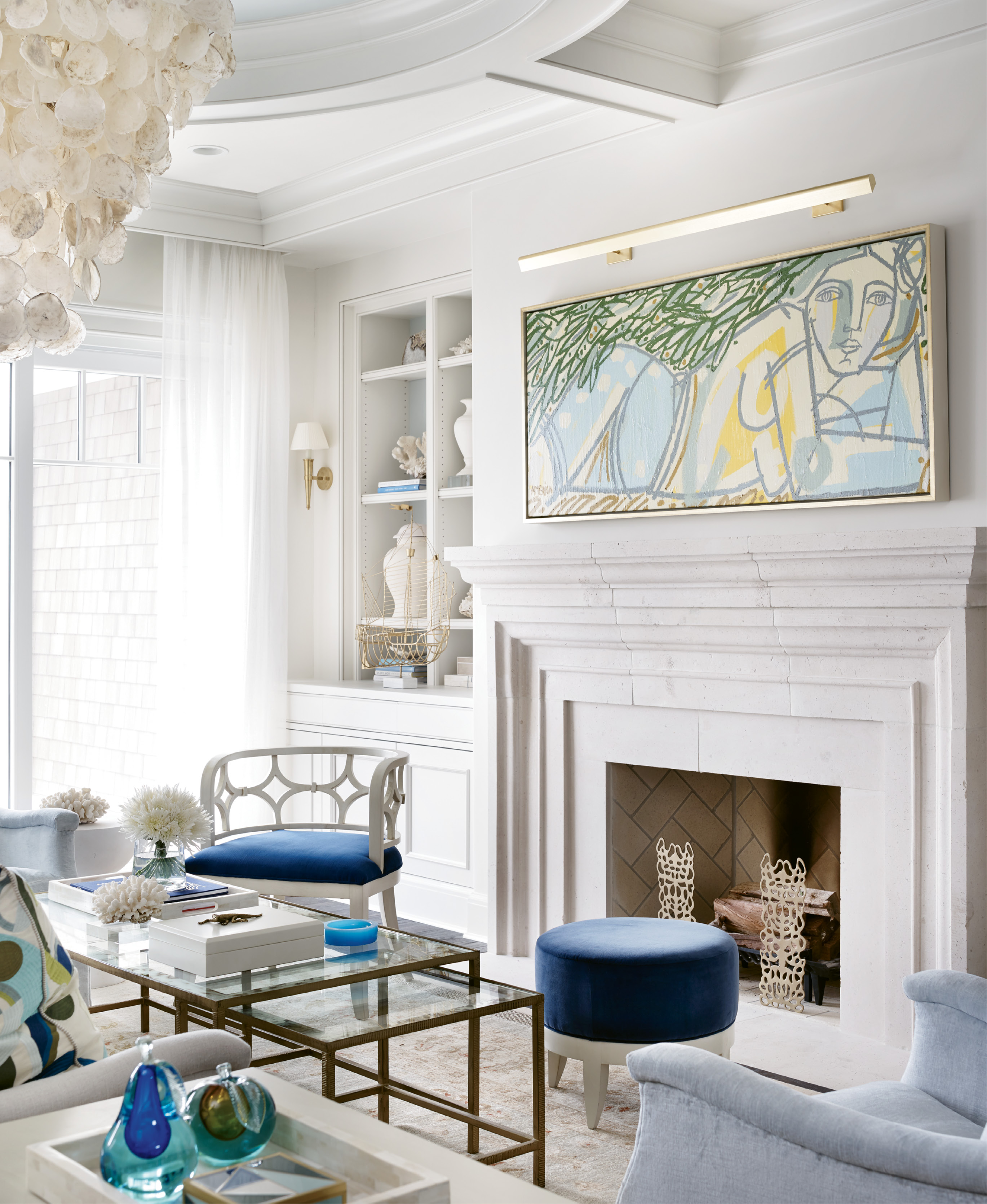 A painting by Colombian-American artist America Martin presides over the hearth.