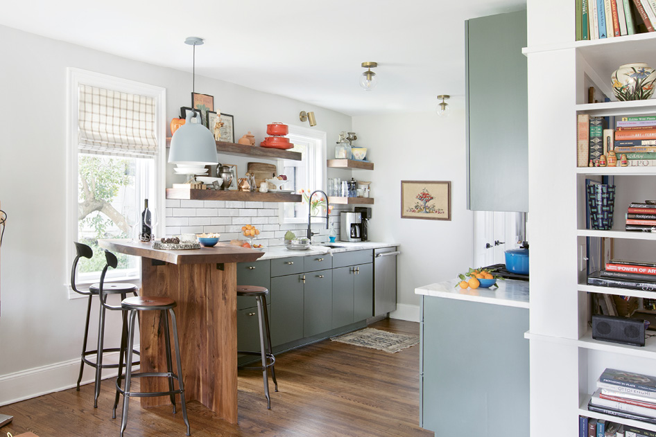 "BEST SEAT IN THE HOUSE: The renovated kitchen is too small for a proper island, but no matter: a walnut bar fabricated by a close family friend delivers similar functionality. ""This has become probably my favorite part of the house,"" Jacques says. ""It's a great place for less formal meals or catching up while one of us is cooking."""