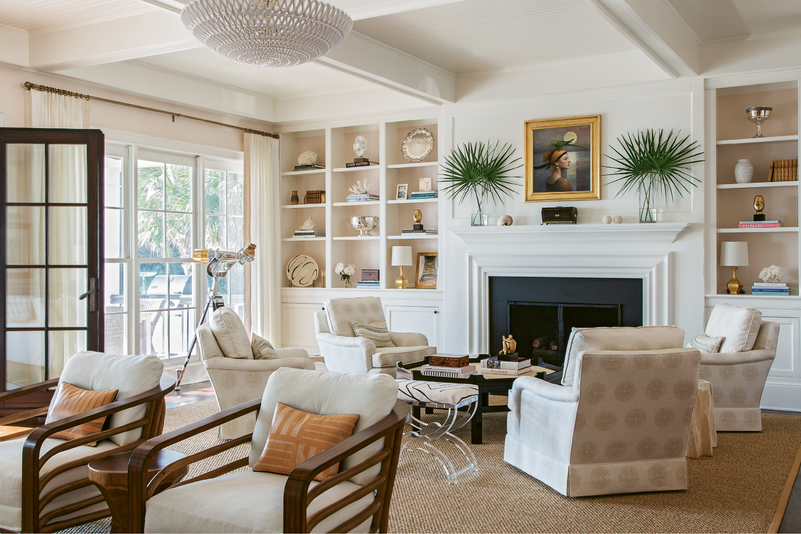 "COASTAL CHARM: The Kings asked designer Allison Elebash to infuse the home with a laid-back island vibe. For the living room, she chose a color palette inspired by coastal landscapes—the walls, for example, are Benjamin Moore's ""Beautiful in My Eyes,"" a rosy hue inspired by the pink sand beaches of the Caribbean."