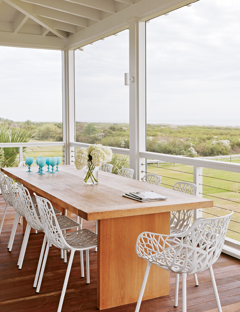 The outdoor dining table echos the home's clean lines.