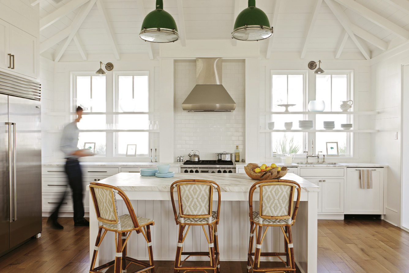 Lights Up: Interior designer Jenny Keenan refashioned two old gymnasium lights, hung by a whipped rope cord, as kitchen pendants.
