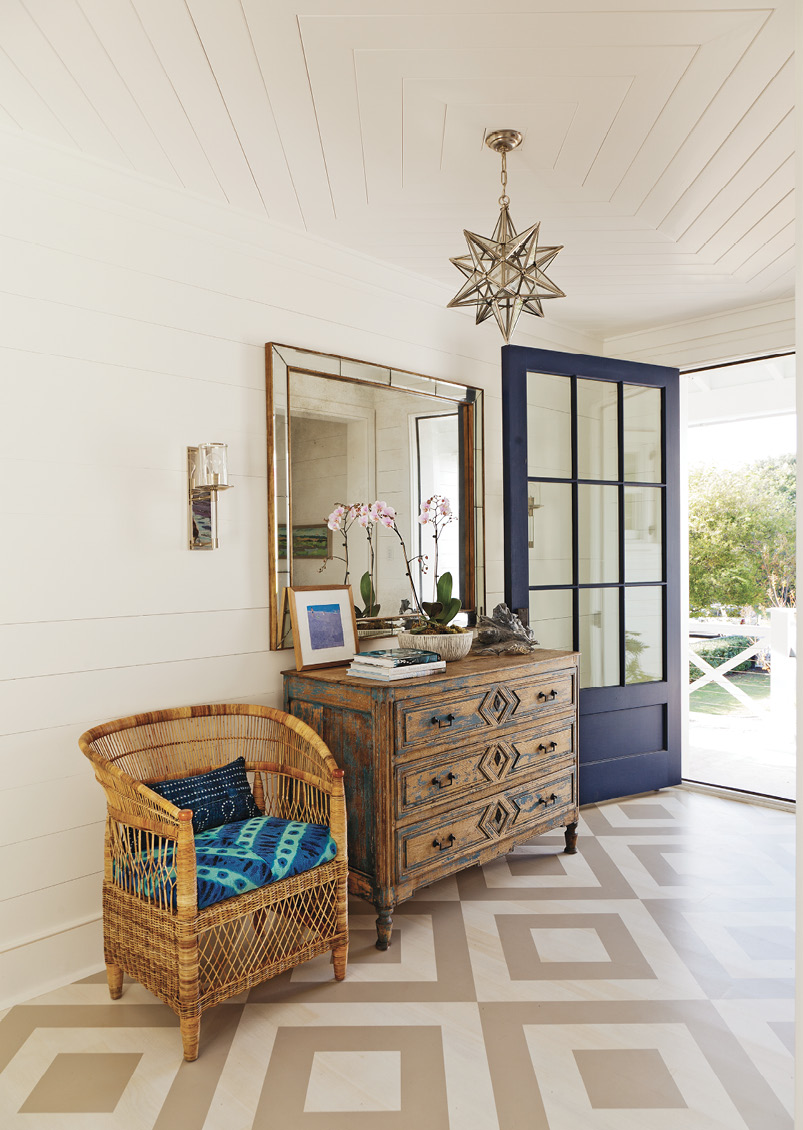 """Pattern Play: The foyer's painted floor """"gives an unexpected punch,"""" says designer Jenny Keenan. It sets the tone for the beautiful yet casual and comfortable interiors the homeowners wanted."""