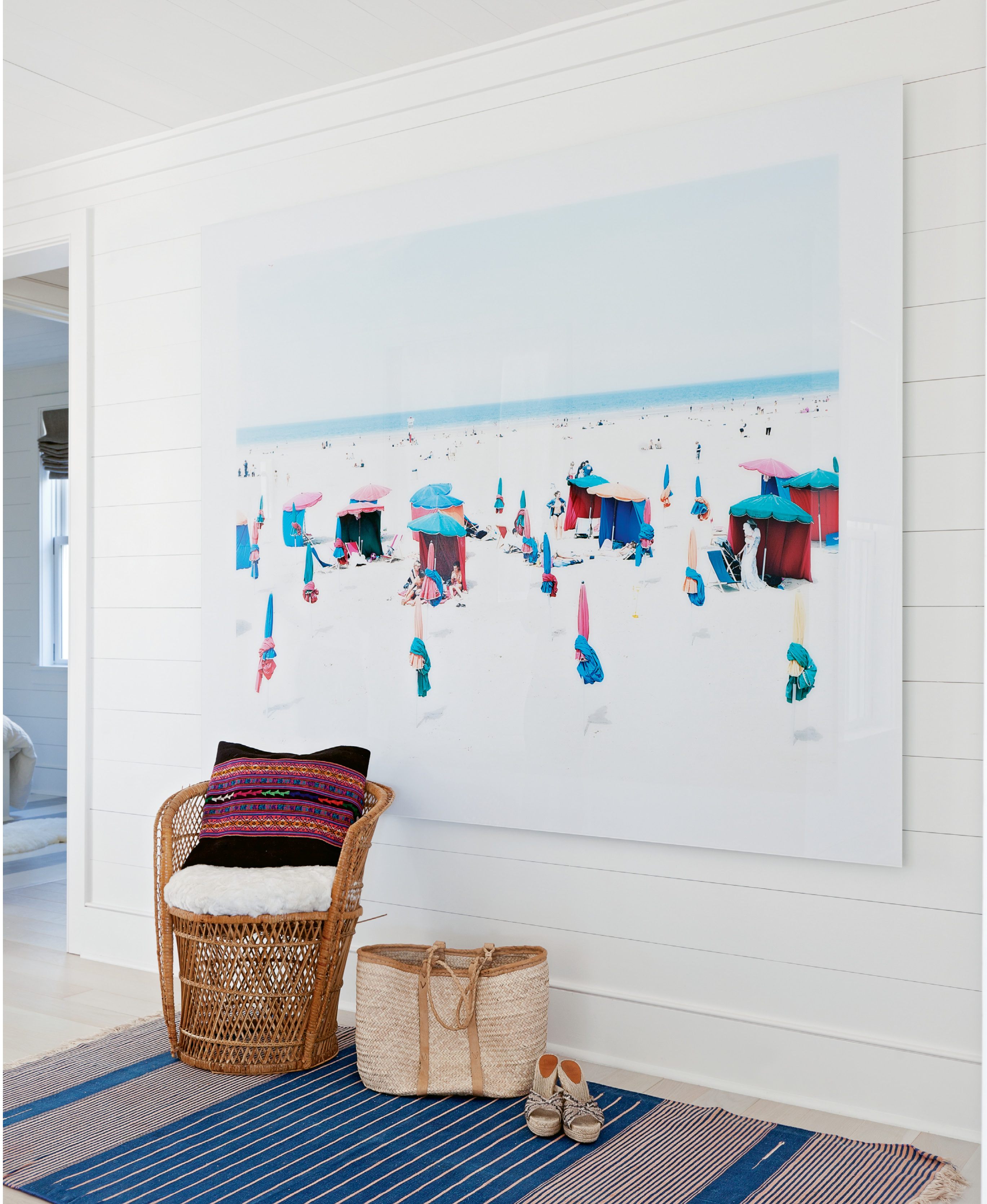 The rooms are filled with fun-in-the-sun decor and artworks, such as this panorama by Italian photographer Massimo Vitali.