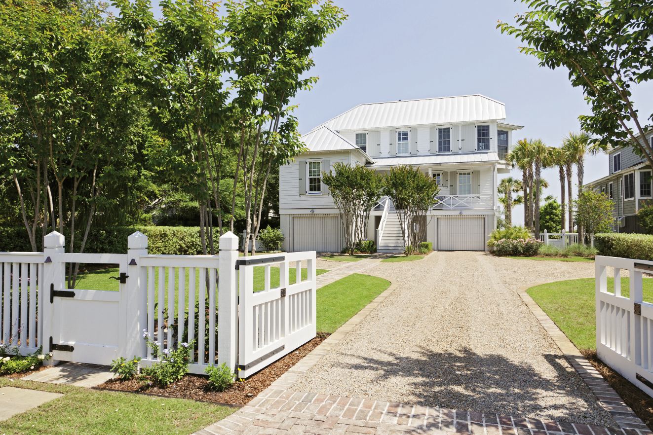 Double Take: Architect Beau Clowney, working with builders Daly & Sawyer, gave the street side of the house a smaller scale, in keeping with old Sullivan's charm, while the beachfront façade is a classic, porch-perfect beach house.