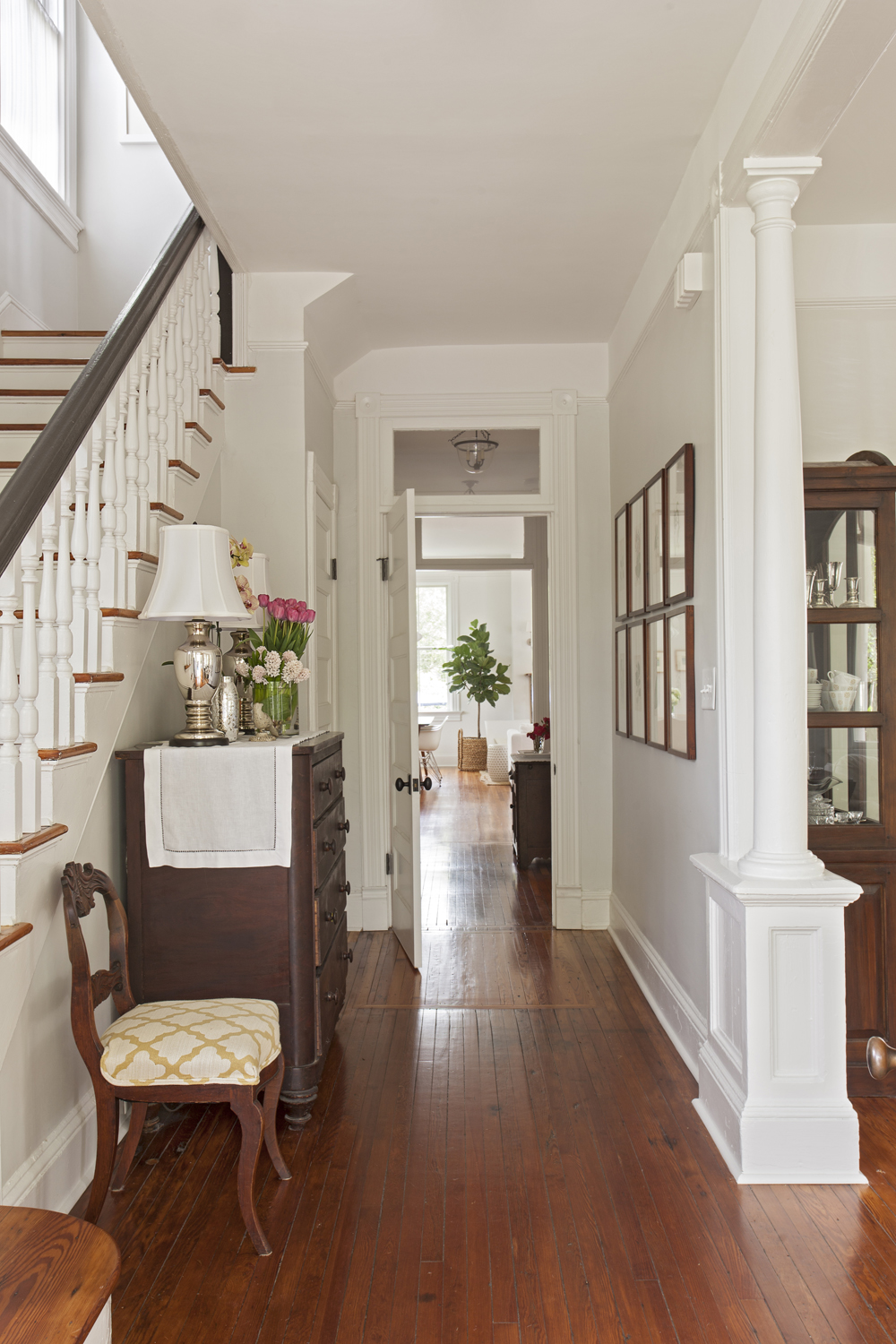 Warm Welcome: In the foyer, guests are greeted by charming original details, such as heart-pine floors and carefully restored millwork.