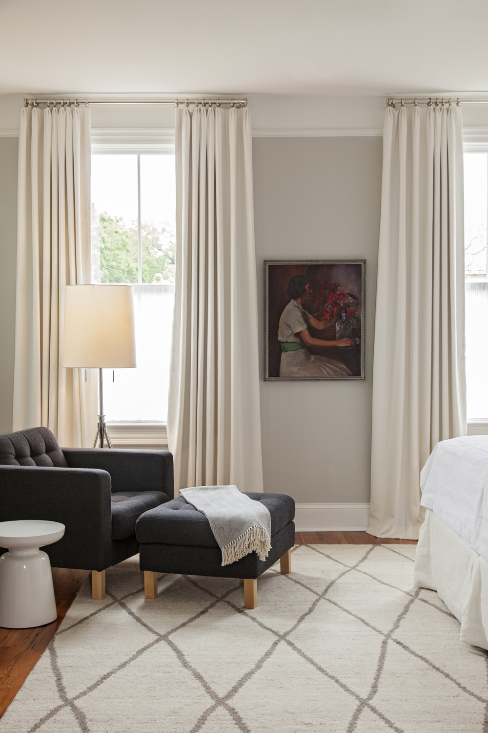 A Piece of the Past: A portrait of Lauren's great-grandmother adds personal flair to the master bedroom.