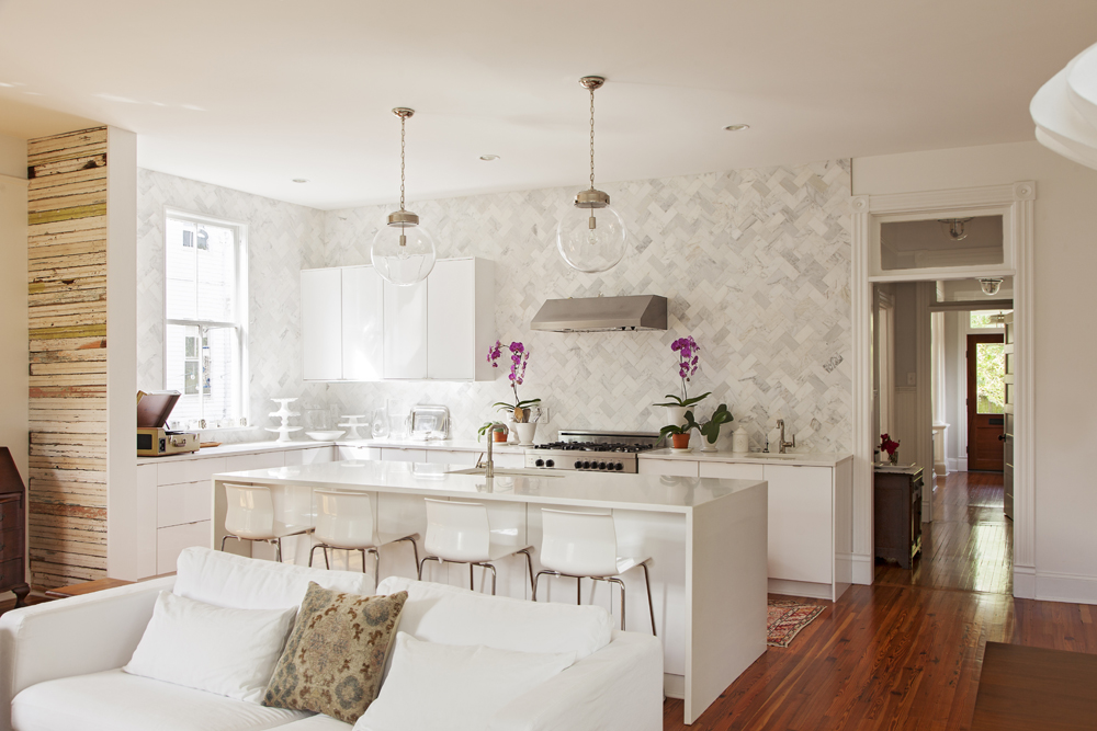 In the kitchen, marble tiles laid in a herringbone pattern are clean-lined and classic.