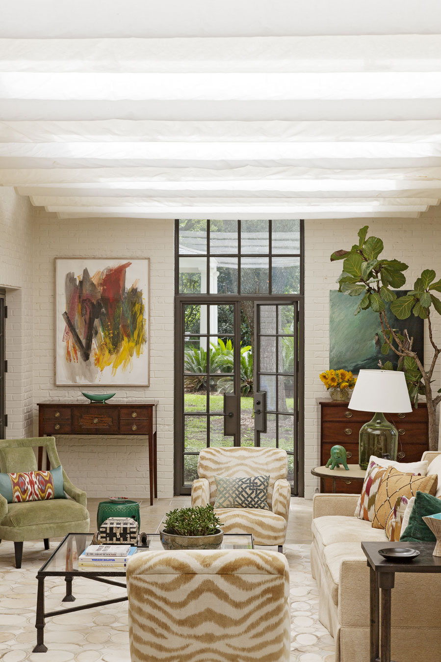 sun catcher: With its glass ceiling, brick walls, and concrete tile floors, the sun porch is architect Bobby McAlpine's update on the sunken dens found in many mid-century homes.