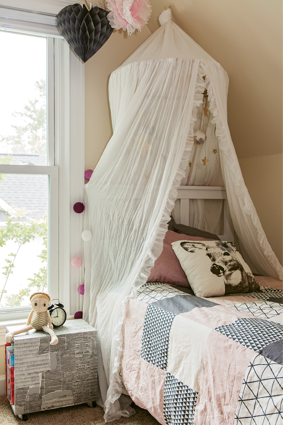 MADE BY MAMA: Therese enjoys DIY projects; her handiwork is evident in Edith's room, which boasts a rolling bookshelf she crafted from a vintage wooden crate bought at auction and patchwork bedding she designed and sewed herself.