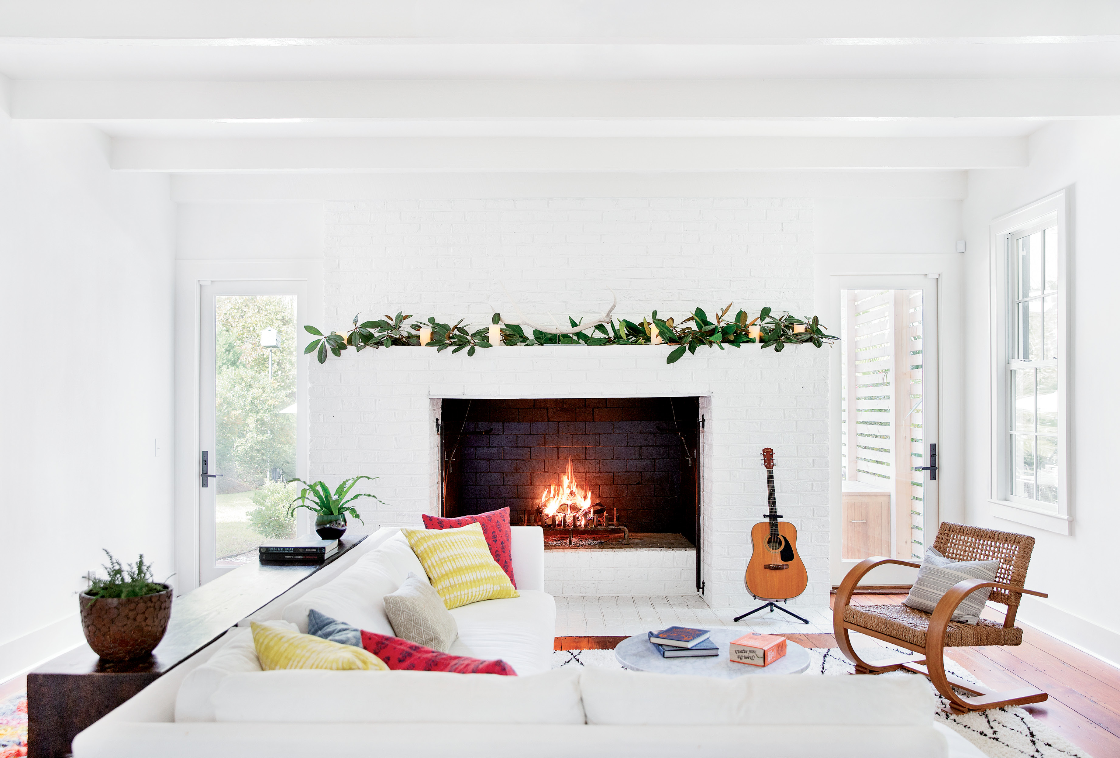 where the hearth is: Thompson redesigned the rear addition, thought to have been built in the 1980s or '90s, to open the living room—with its massive, inviting fireplace—to the rest of the house.