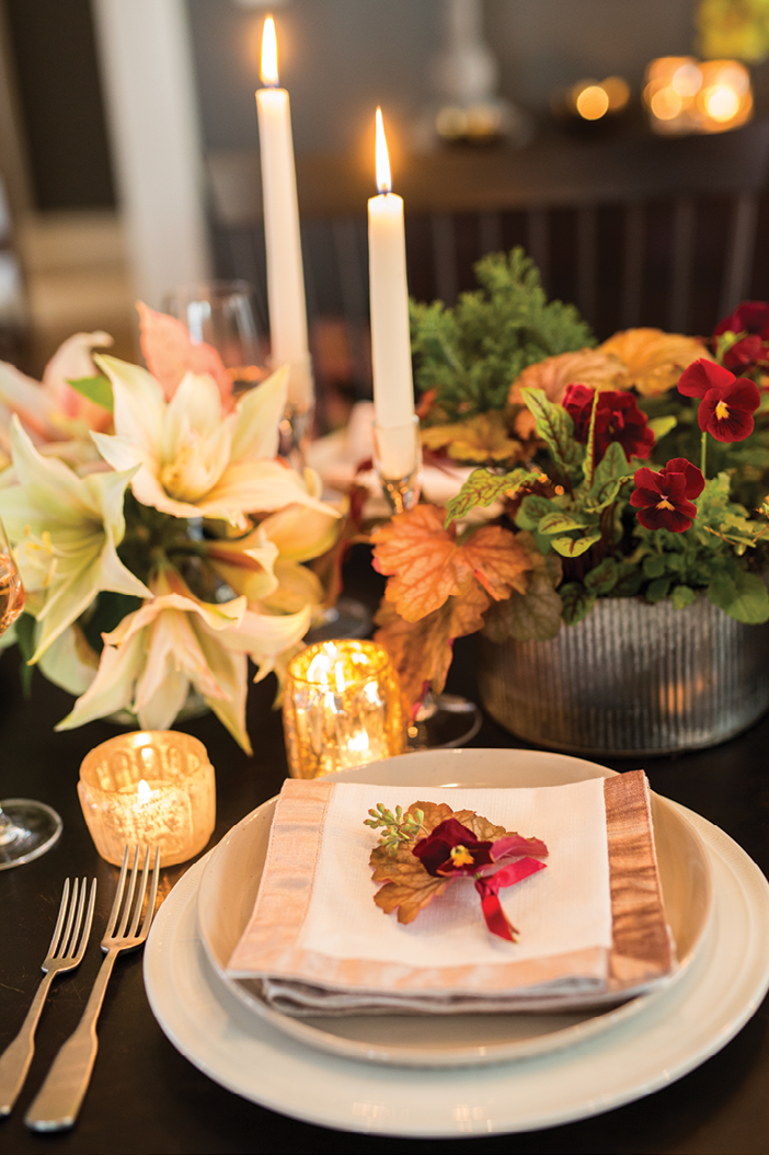 """""""You can make almost any palette work for the holidays with the addition of seasonal foliage,"""" she says. In this case, poinsettias in newer pink and white varietals add festive flair."""