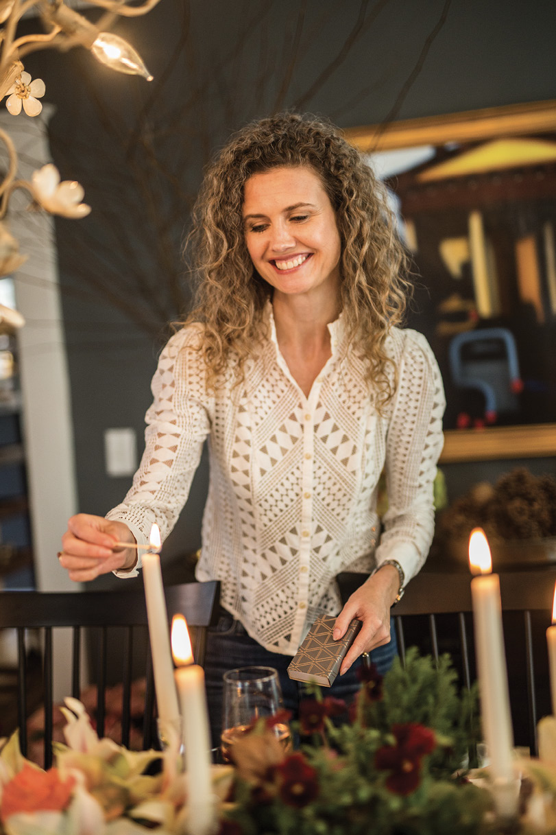 """Incorporate candles of different heights. """"Tapered candles are elegant, and lower candlelight—such as votives—casts a warm glow upward, which is flattering,"""" Heather says."""