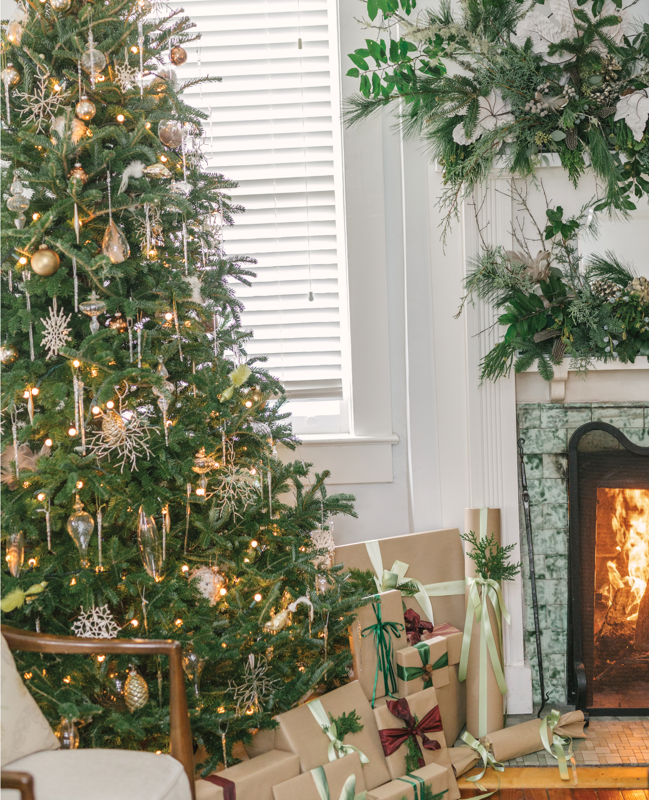 First lights strung at varying depths, then showcase ornaments in spot where they can be best seen and enjoyed, fill in evenly with baubles, and finally glass icicles.