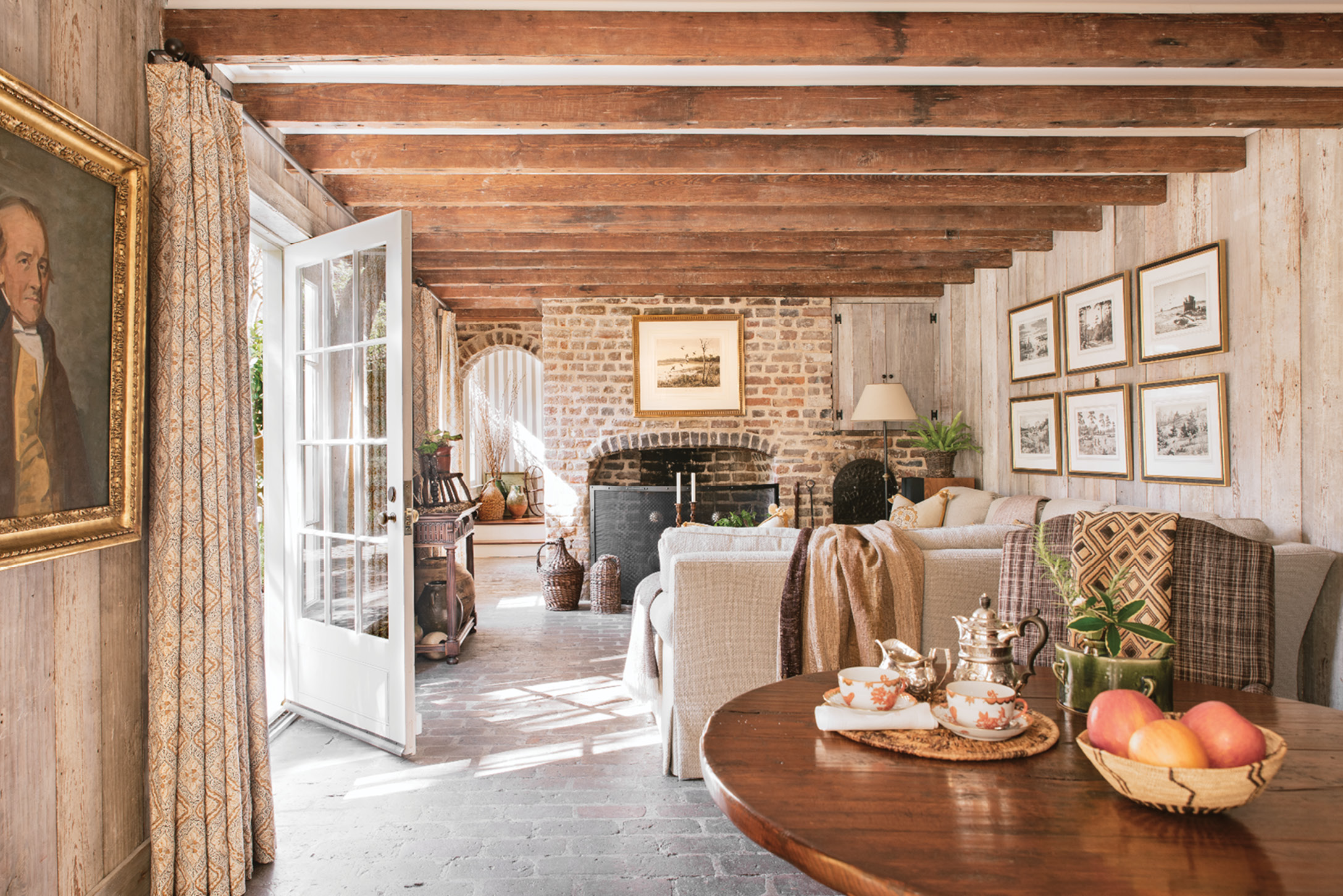 This family room and breakfast area are within what was once a separate kitchen house; a previous owner had the rear building connected to the main structure via a hyphen.
