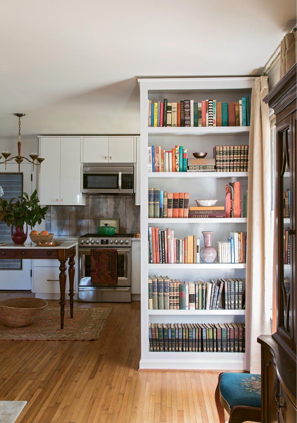 SHELF LIFE: To modernize the layout, Glennon advised taking down the wall separating the kitchen and dining nook. In its place, she added built-in bookshelves that keep the space visually open while still clearly defining individual rooms.