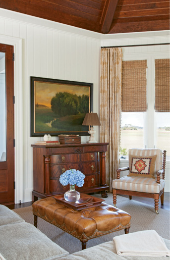 The handsome den with its vaulted wood-paneled ceiling