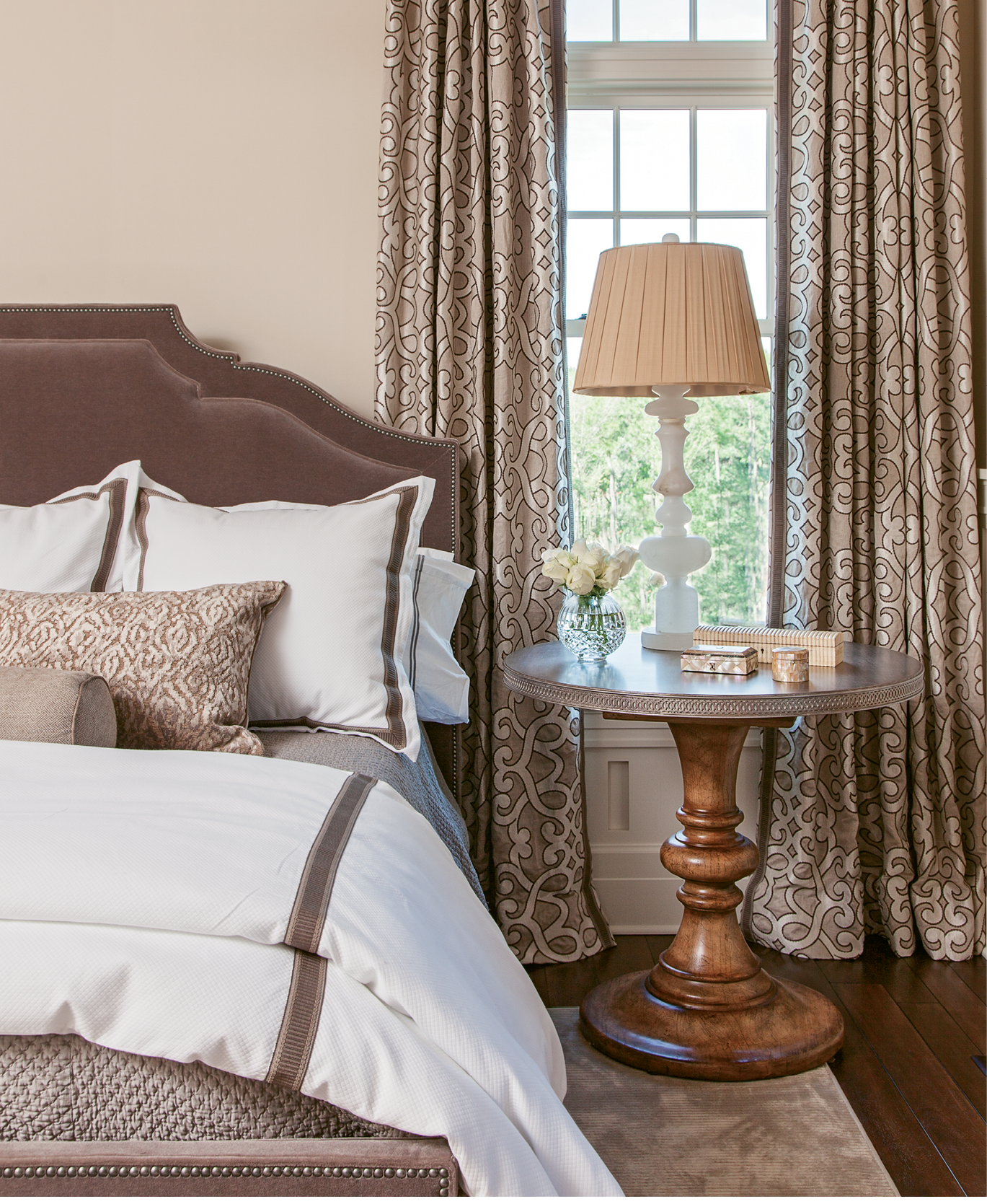 """CURTAIN CALL: """"The master bedroom design was driven by the curtain fabric by Schumacher,"""" Ervin says. """"Kelly just fell in love with it."""""""