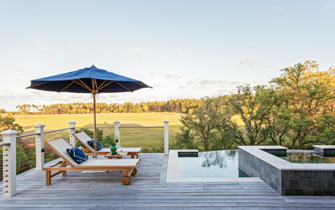 VIEWFINDER: Kingsley-Bate outdoor furnishings and a bluestone hot tub provide plenty of vantage points for taking in the backyard's creek vistas.