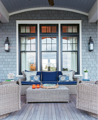 An inviting porch beckons at Kelly and David Lyle's custom creekfront abode on Daniel Island. Check out the newlyweds' laid-back yet luxurious style in The Charleston Home.