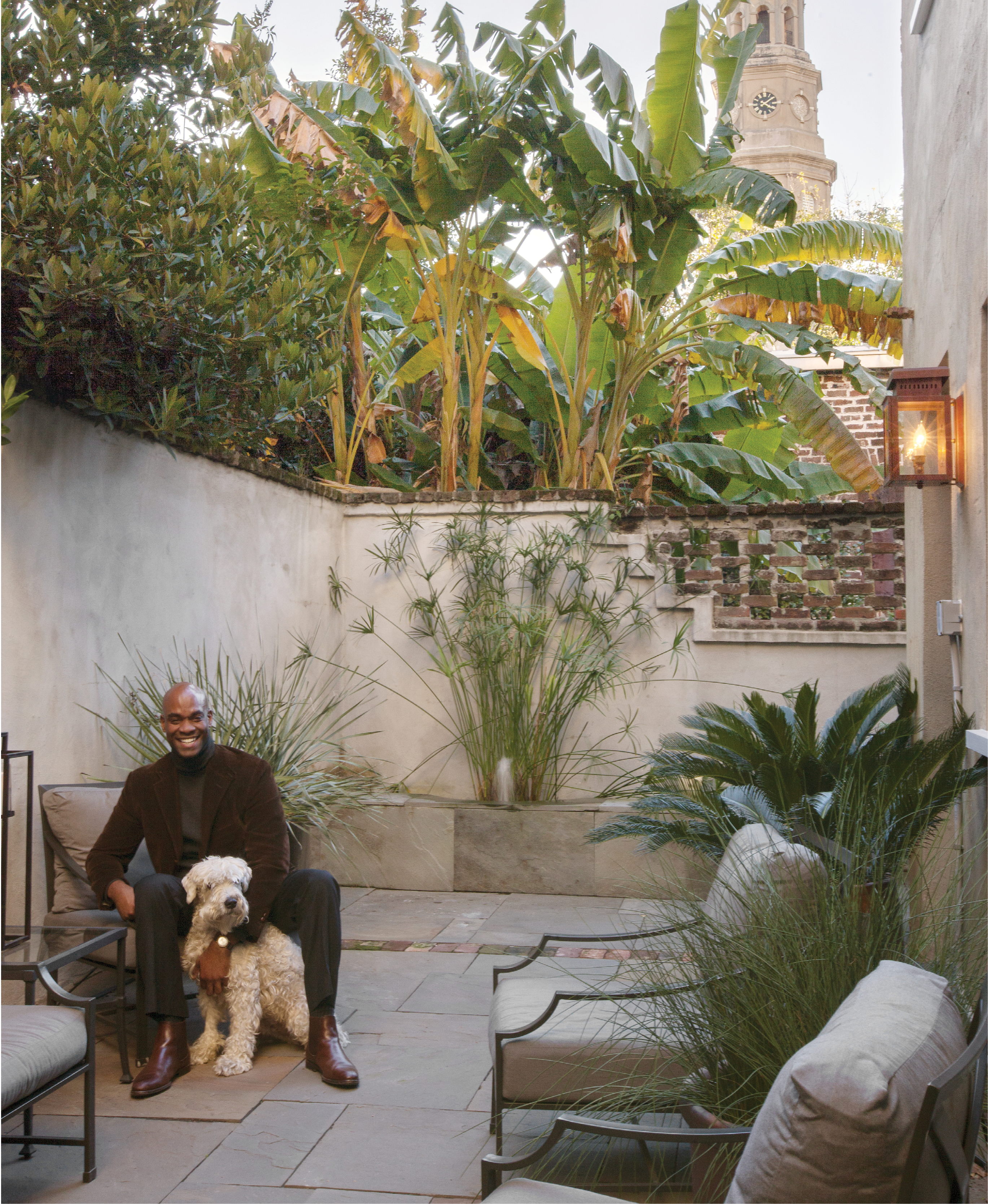 """Green Room: Irions says his private courtyard, which boasts a view of the steeple of St. Philip's Church, is like another room of the house. """"I am very proud to be a new member of this community and so grateful to call Charleston home,"""" he says."""