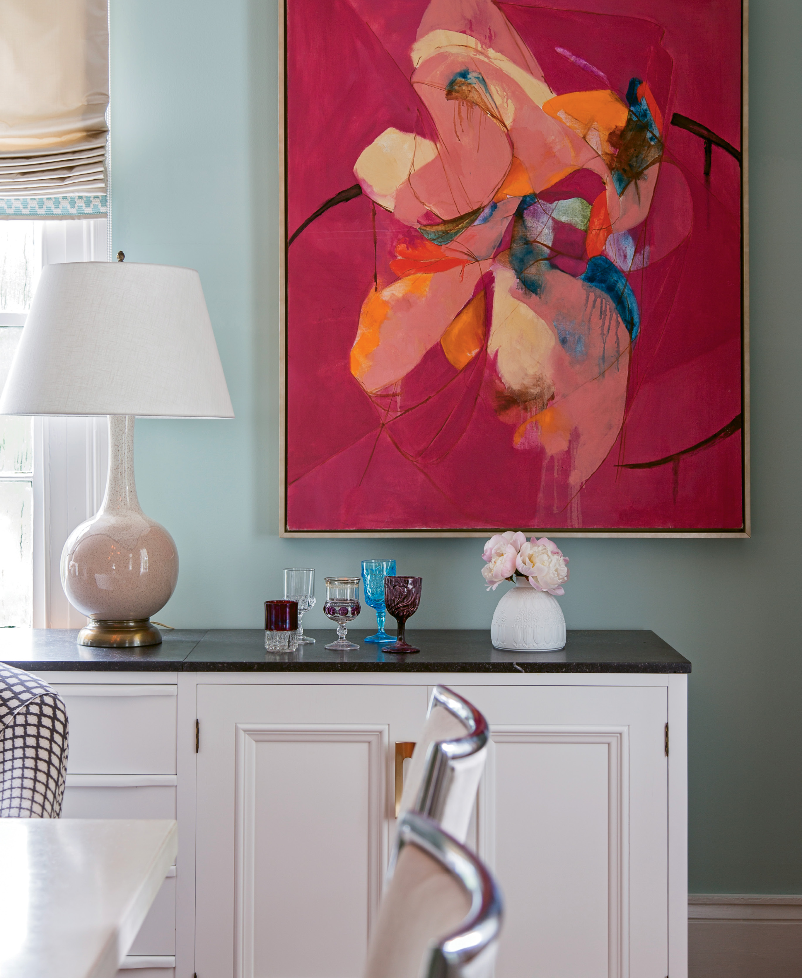 In the Old Village, a family of Brooklyn transplants revives a historic abode with their youthful energy and vibrant art collection, which includes the likes of this mid-century floral painting scored at High Point Market.
