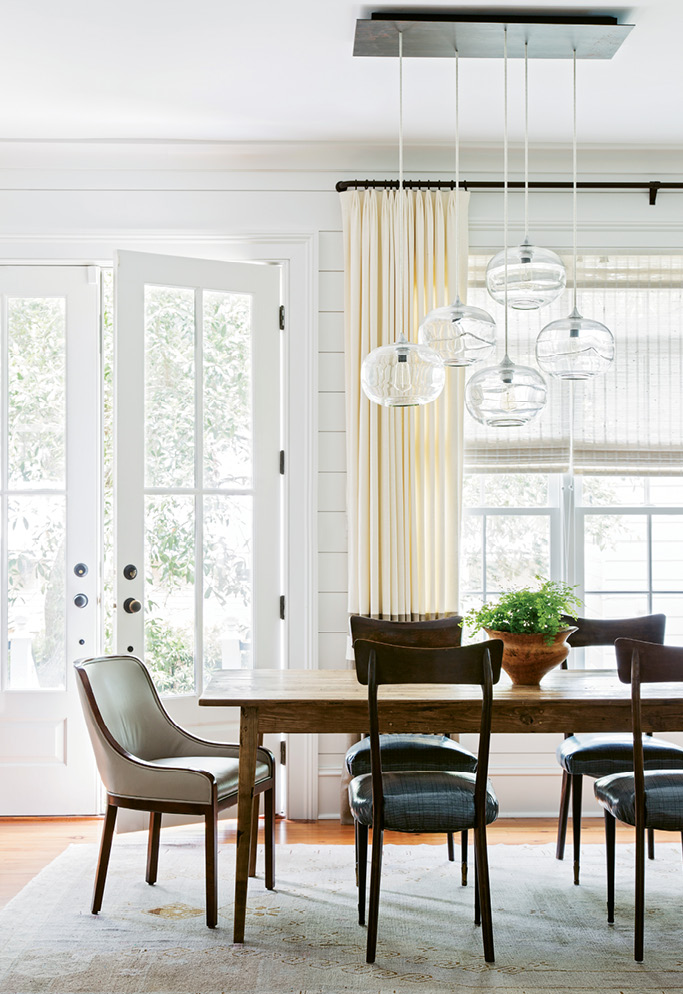 """IN THE SPOTLIGHT: Sculptural light fixtures, such as this hand-blown glass number by John Pomp, were added throughout. """"They're really like works of art,"""" Melanie notes."""
