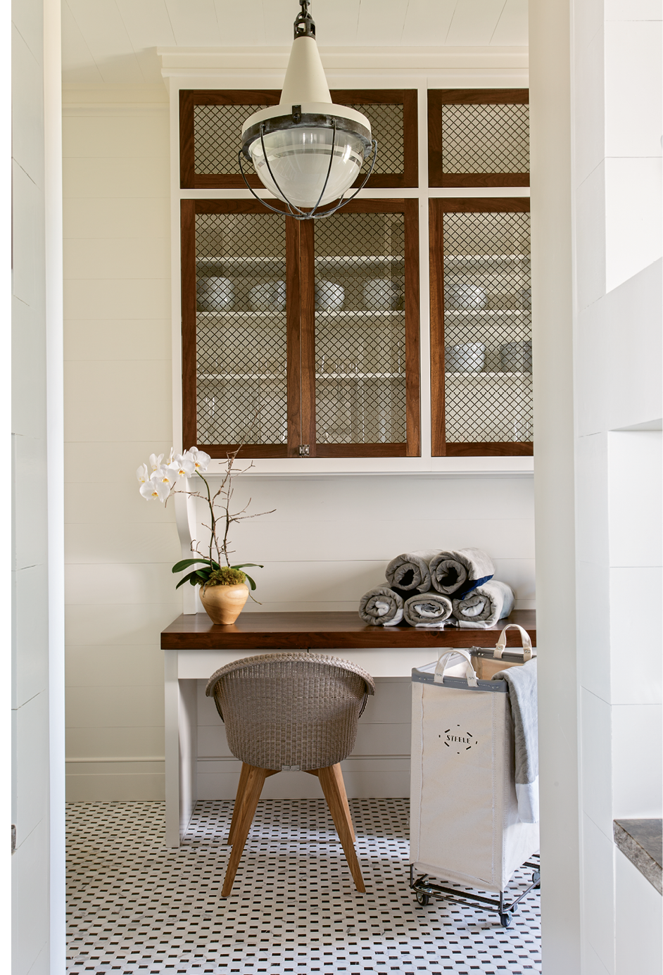 Vintage Charm: In the laundry room, walnut accents and a vintage-inspired Urban Electric light fixture set a nostalgic tone.