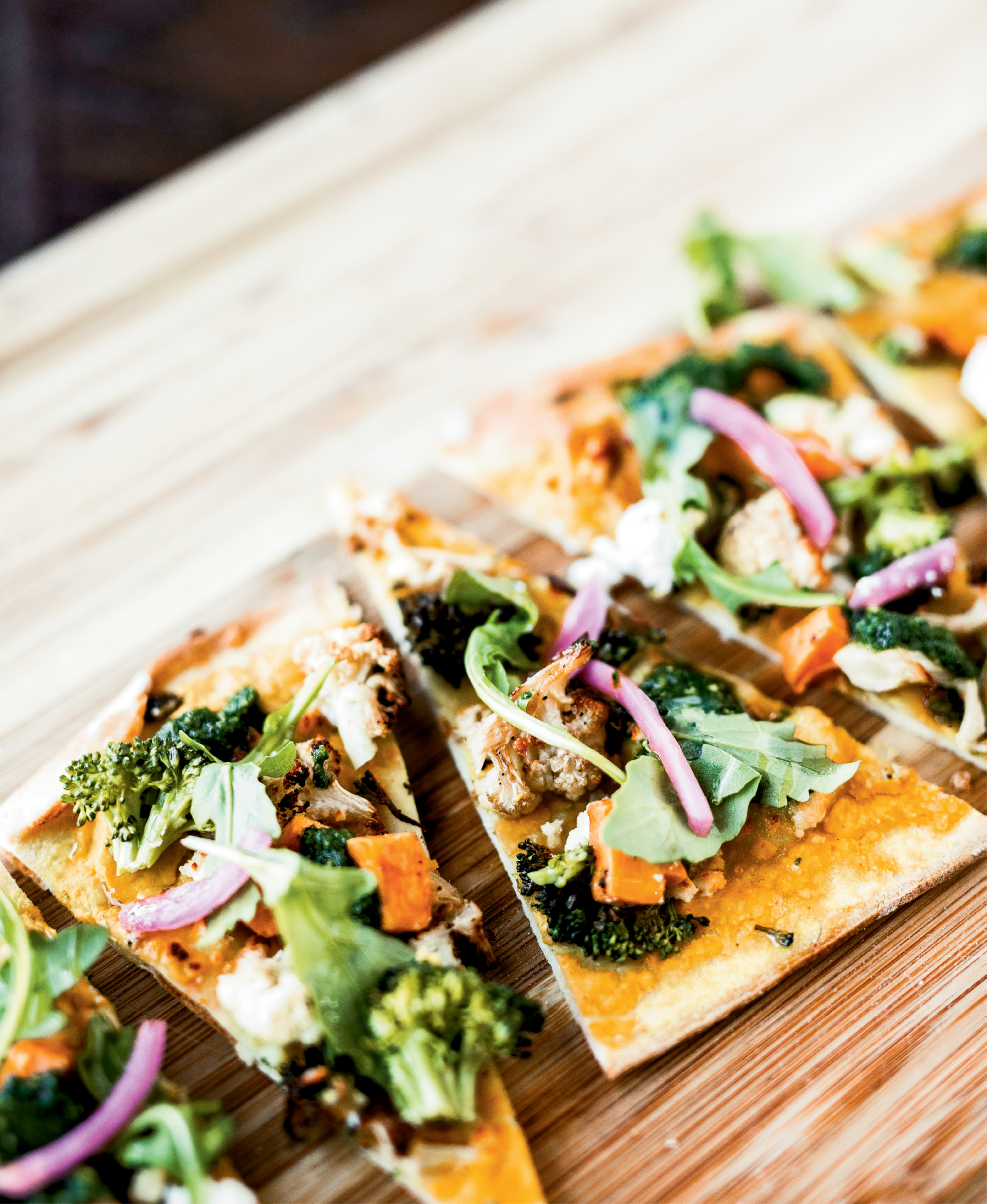 Fresh-picked produce was the norm when executive chef Brannon Florie visited his grandfather's Mount Pleasant farm growing up. Now, he uses local sweet potatoes, broccoli, cauliflower, and other vegetables to add flavor to flatbread at The Granary.