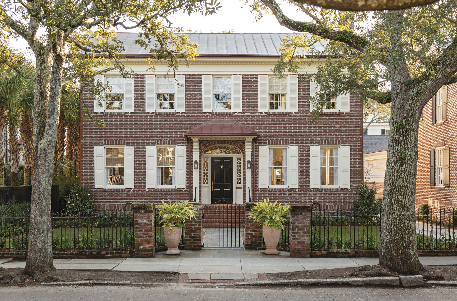 "HIP TO BE SQUARE: Working with an architect, a builder, and an interior designer, Cate and Hugh Leatherman updated a boxy brick Colonial-style house South of Broad to suit their brood.   ""I love how neighborhoody it feels here,"" says Cate, who grew up around the corner. ""It has a family vibe."""