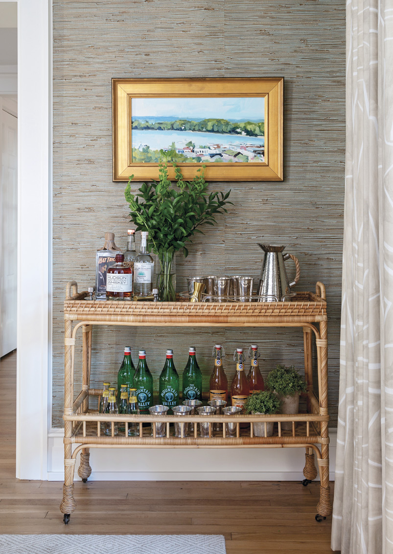 A Serena & Lily bar cart anchors a painting by Michigan artist Richard Kooyman.