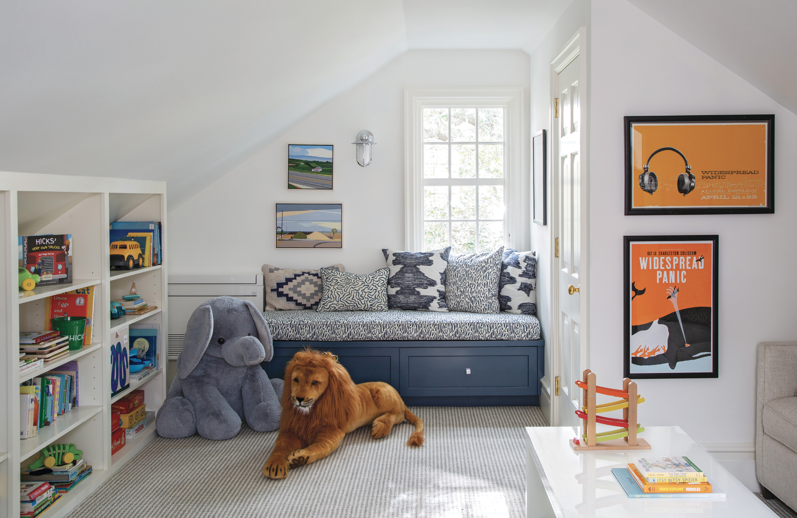 FLAIR PLAY: After connecting the room above the garage to the house via a new multipurpose laundry room/office, it became a playroom, with plenty of space for Tucker and Hicks to commune with their toys and their dad's poster collection.