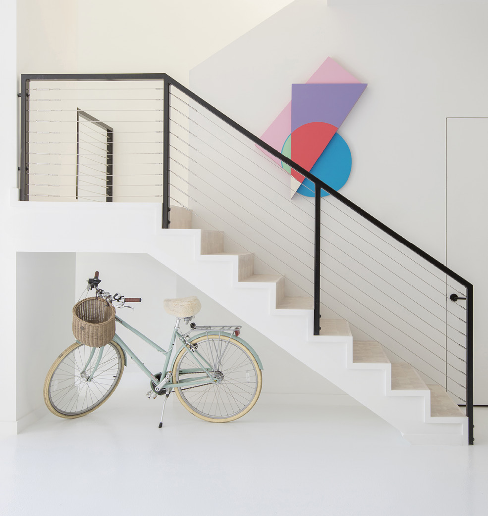 Jonathan Rypkema's pastel wood panel provides a burst of color above the stairwell.