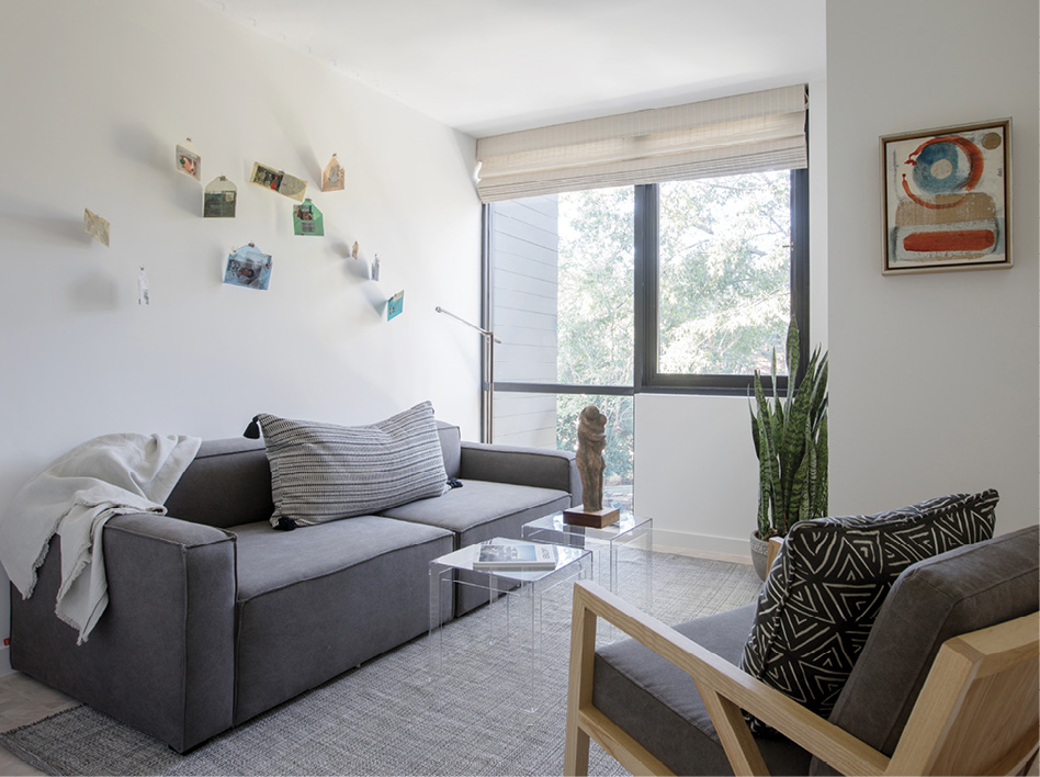Upstairs, an installation by Celeste Caldwell adorns a wall of a guest bedroom/sitting room with a modular sofa from Gus* Modern.
