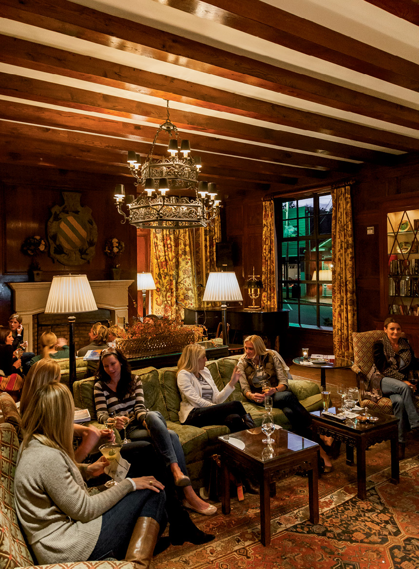 Guests gather for cocktail hour in the inn's Hummingbird Lounge