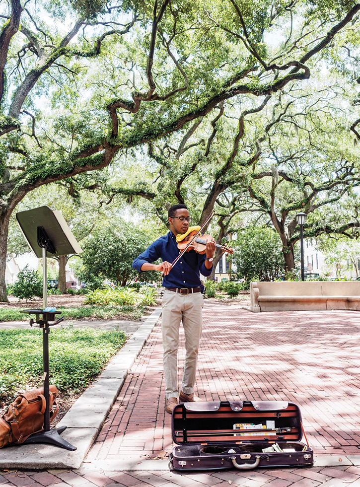 """Violinist Michael Houston of Beaufort says he prefers playing in Savannah squares because """"people are more relaxed"""" and listen awhile."""