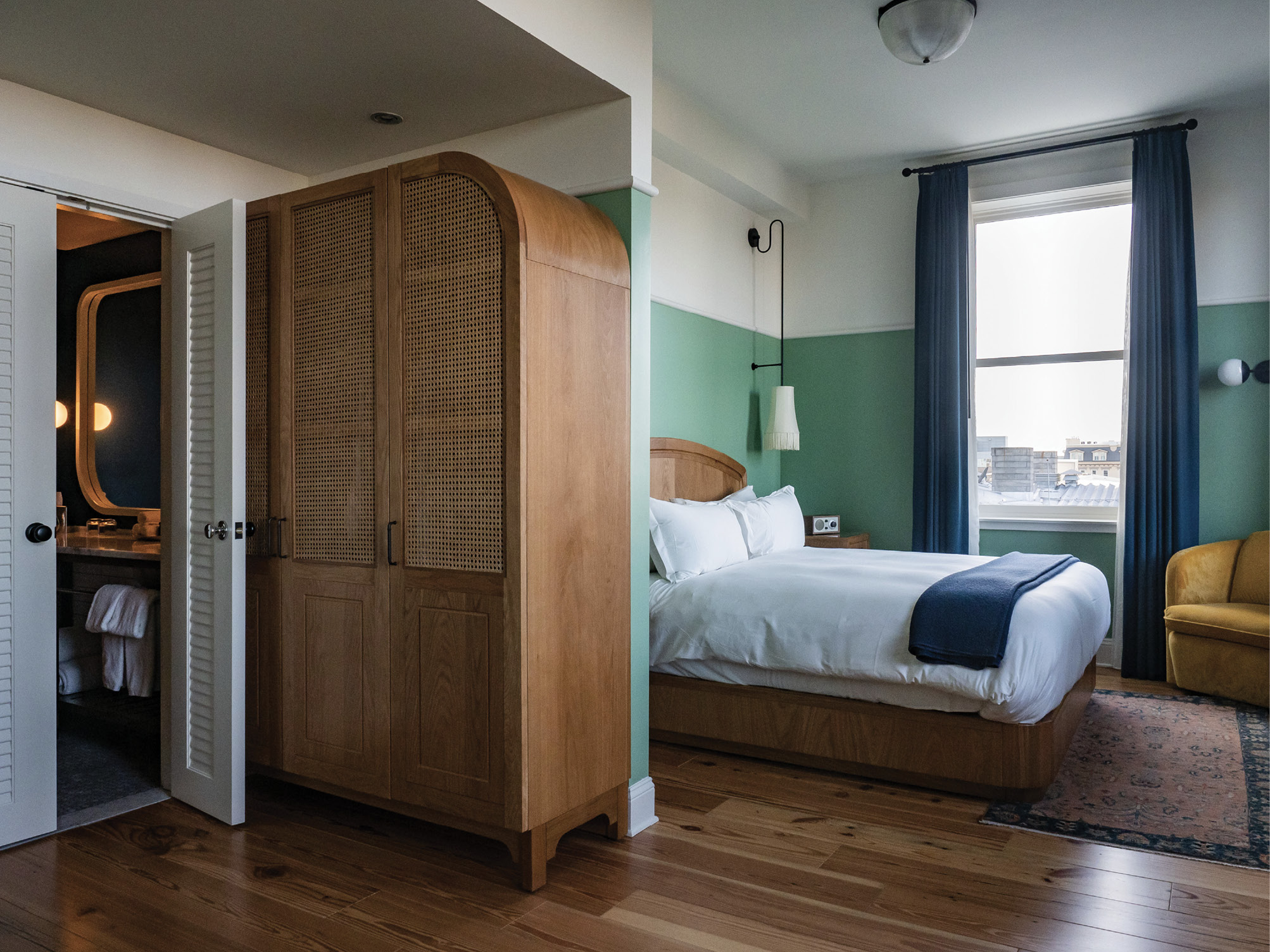 A fifth-floor guest room with downtown views
