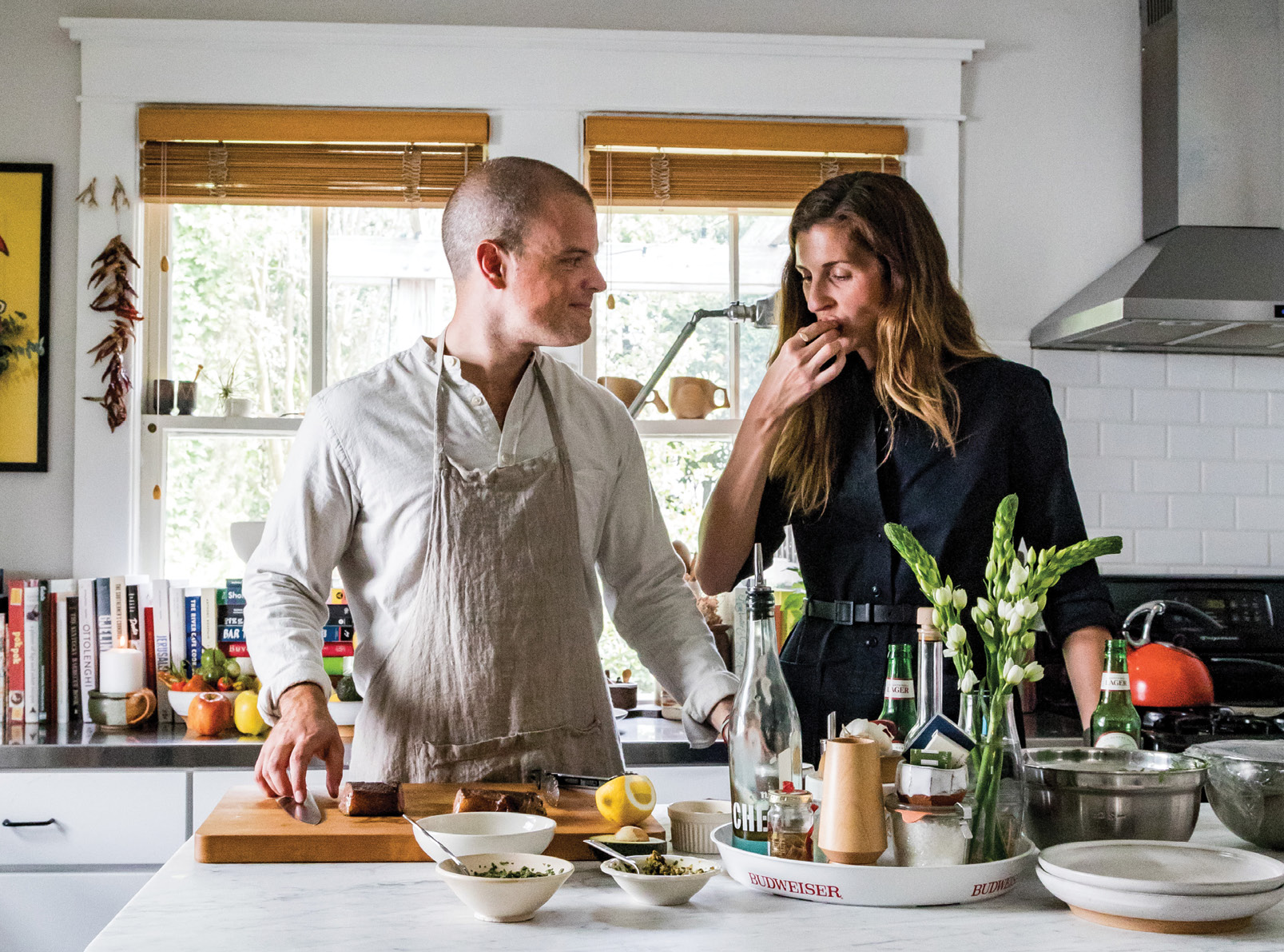 Restaurateur Brooks Reitz and his wife, Erin, prep a vibrant autumn meal in their North Central home.
