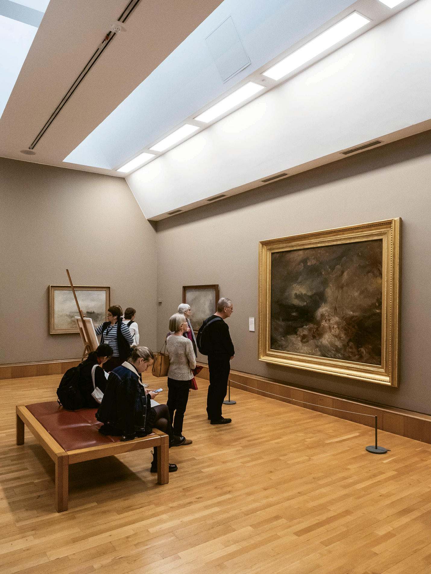 """...as well as """"Stormy Sea,"""" a collection of works by English painter J. M. W. Turner."""
