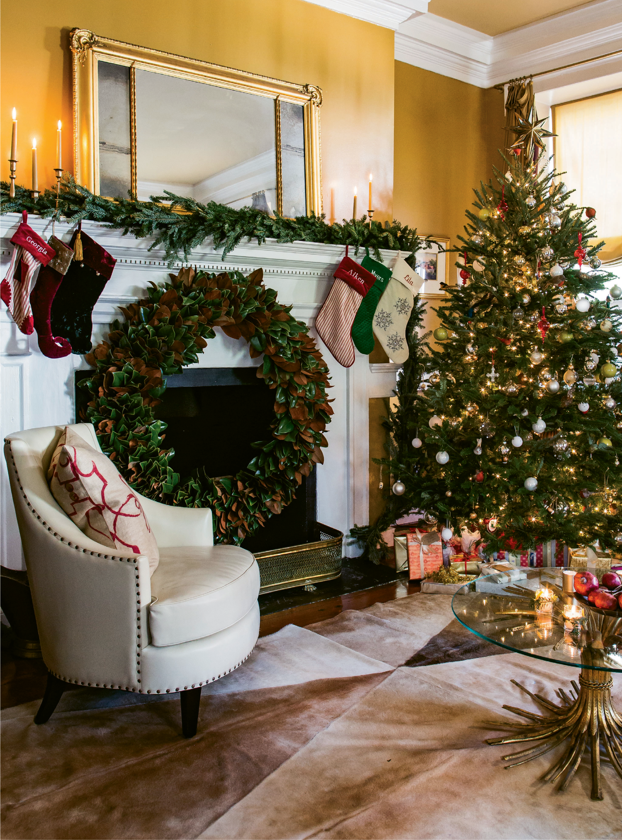 """LIGHT IT UP: A Christmas tree with lights and presents more than suffices for décor this time of year, says Tara. She added simple metallic balls and her children's homemade ornaments to the mix. TIP: Tara's go-to for """"thick, gorgeous foil wrapping paper"""" is T.J. Maxx."""