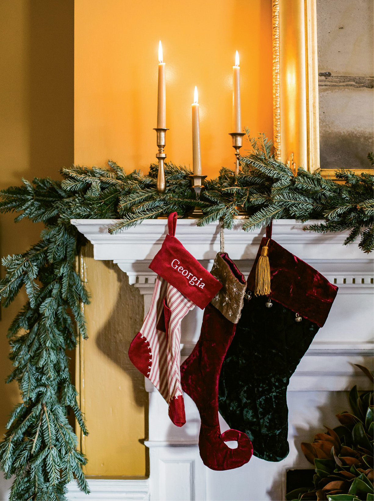 """HANG WITH CARE: Simply weaving garlands amid mantel decorations works for Tara, as does lighting candles. """"Just don't burn scented candles around food,"""" she says."""