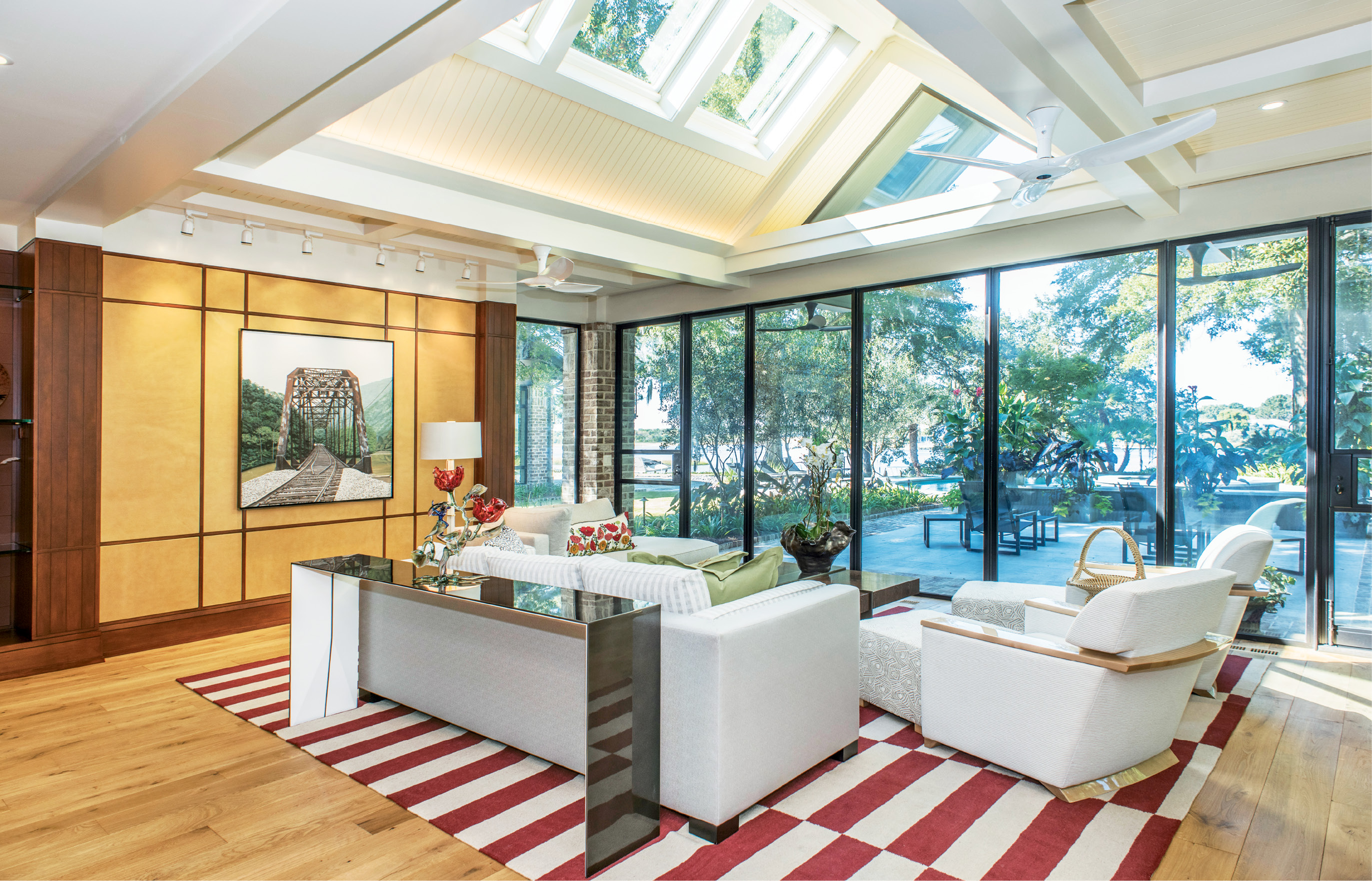 An Easy Out: Contemporary, casual, and flooded with light, the den is a sun-room and then some.