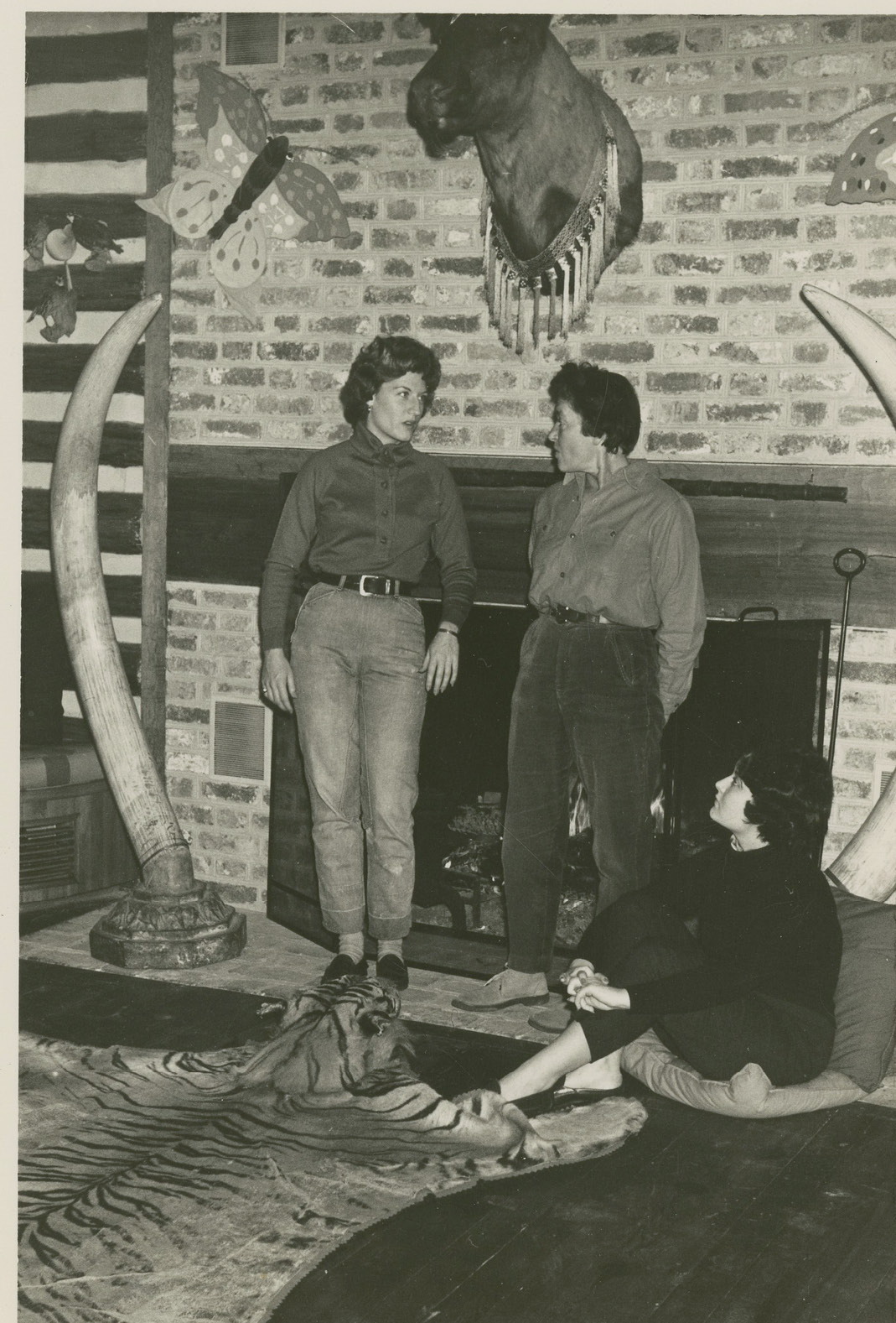 """With daughters Landine and Bokara (seated) in Medway's """"Trophy Room,"""" undated"""