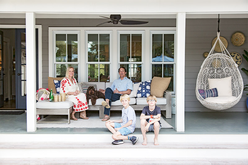 Allison and Bright Williamson; their 11-year-old twins, Ben and Henry; and Labradoodle Chief relax on the back porch.