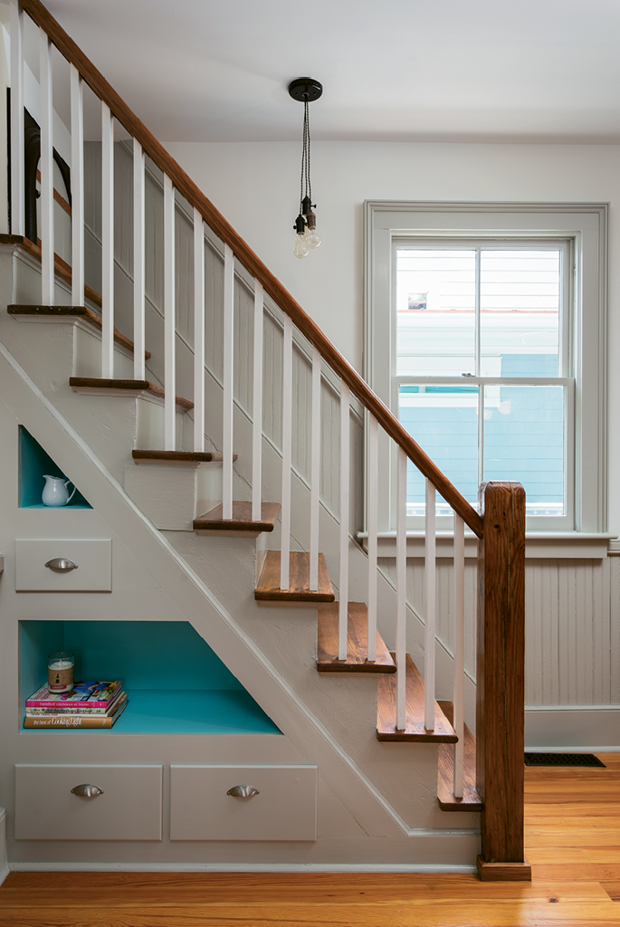 The former service stairs now function as an interesting focal point in the kitchen, as well as a fun play space for visiting grandchildren.