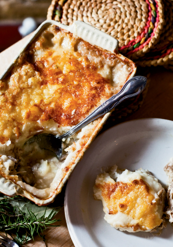 While the haché parmentier recipe calls for tender pulled pork, Perig notes that any type of meat can be layered into this French shepherd's pie, and vegetables can easily be added to the dish.