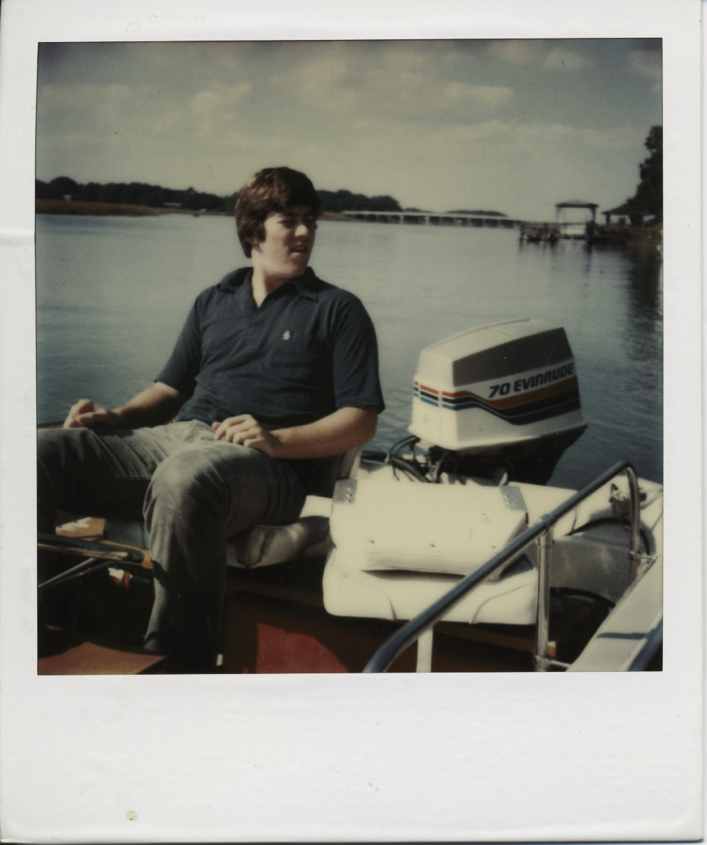 Author Julian Buxton as a 15-year-old in his boat