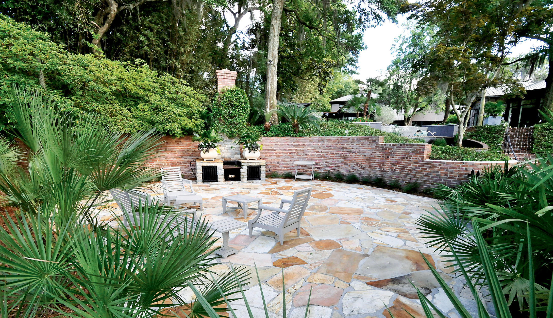 Iron grates were added to the existing brick fireplace to dress it up a bit. The outdoor room is a popular spot for oyster roasts and entertaining.