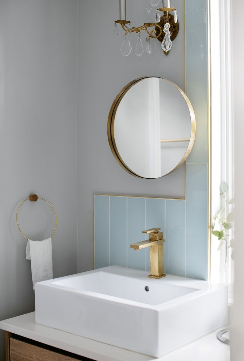 In the master bath, contemporary mirrors from Hausful commingle with antique sconces for a look that's both vintage and modern.