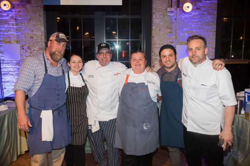 Harleston Village chefs, including Patrick Owens, John Zucker, Michelle Weaver, and Nico Romo, pose for a photo.