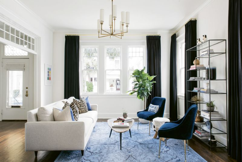 "BOLD STROKES - Stay-at-home mom Alison—who studied fashion at the Art Institute of Charleston and worked in retail for years—craved a ""fun, glamorous, and definitely not too serious"" design, says Lenox. In the light-filled living room, a mid-century modern sofa from Room and Board is glammed up by Scalamandré leopard print and Jonathan Adler blue velvet pillows."